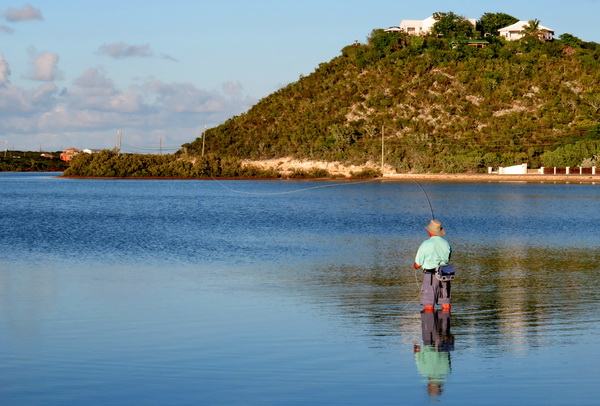 Lakeside bonefishing just steps from fishing lodge at Harbour Club Villas and Marina on Provo Turks and Caicos Islands