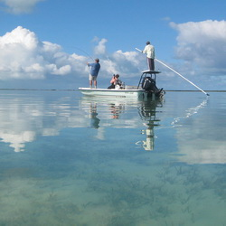 Catching bonefish while bonefishing with a guide
